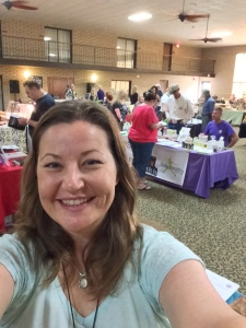 A selfie from my Reiki booth at the Alternative & Holistic Fair, July 2014, in Park City, Kansas.