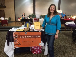 "Here I am with my ""You Deserve Reiki"" booth at the Alternative & Holistic Fair in Park City, KS, March 2015."